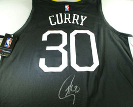 "STEPHEN CURRY / AUTOGRAPHED G.S. WARRIORS ""THE TOWN"" BLACK NBA JERSEY / BECKETT image 1"