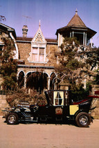 The Munsters Classic Car Outside Mansion TV Cult 18x24 Poster - $23.99