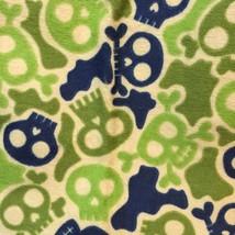 "JoAnn Fabric Flannel Skulls Bones 0.72 yards x 42"" wide 2-Tone Green Blue Tan - $9.89"