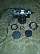 Caonon AE-1 35mm Camera - FD 50mm 1:1.8 Lens - Lens Adapter's and cap's - $145.00