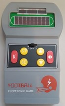 FOOTBALL HAND HED ELECTRONIC GAME VINTAGE 1970'S MODEL 003201  - $13.85