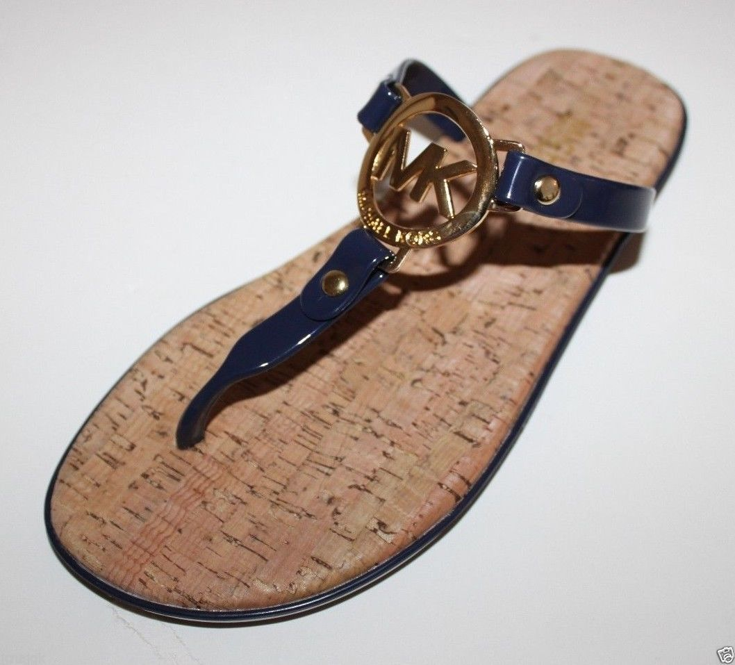 65e1f091aaa1 S l1600. S l1600. Previous. Michael Kors NWOT Womens Navy Bue Flip Flop Charm  Jelly Sandals Cork