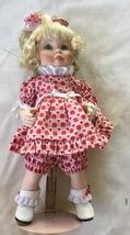 Charlott by J porcelain doll with heart dress - $18.00