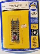 AHM Vintage HO Scale Complete Operating Bumper with Light 2526  - $6.92