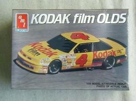 FACTORY SEALED AMT/Ertl #4 Kodak Film Olds #6731 - $9.89