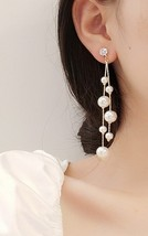 Small Pearl Long Drop Earrings - $25.00