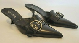 PRADA Black Leather Mules with Silver Buckle & Grommet Detail - Size 37 - $59.39