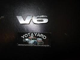 2005-2015 TOYOTA TACOMATAIL GATE EMBLEM 75471-04030 OEM YOTA YARD. - $14.85