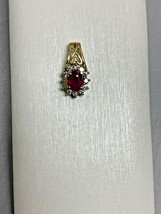 RUBY AND DIAMOND PENDANT IN 14K YELLOW GOLD  - $345.51