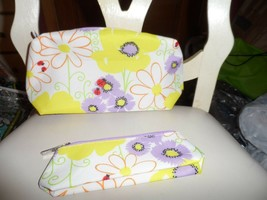 Set of 2 white floral cosmetic bags with lady bugs from Clinique - $8.99