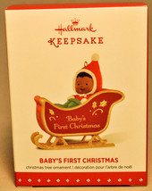 Hallmark: Baby's First Christmas - Baby in Sled - 2015 Ornament - $8.10
