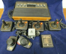 ATARI 2600 Video Computer System 4 Joysticks 2 Paddles Video Olympics Cartridge - $169.14
