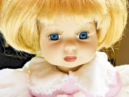 Geppeddo Porcelain Doll Blonde Hair Blue Eyes laying Down Collector's Se... - $17.81