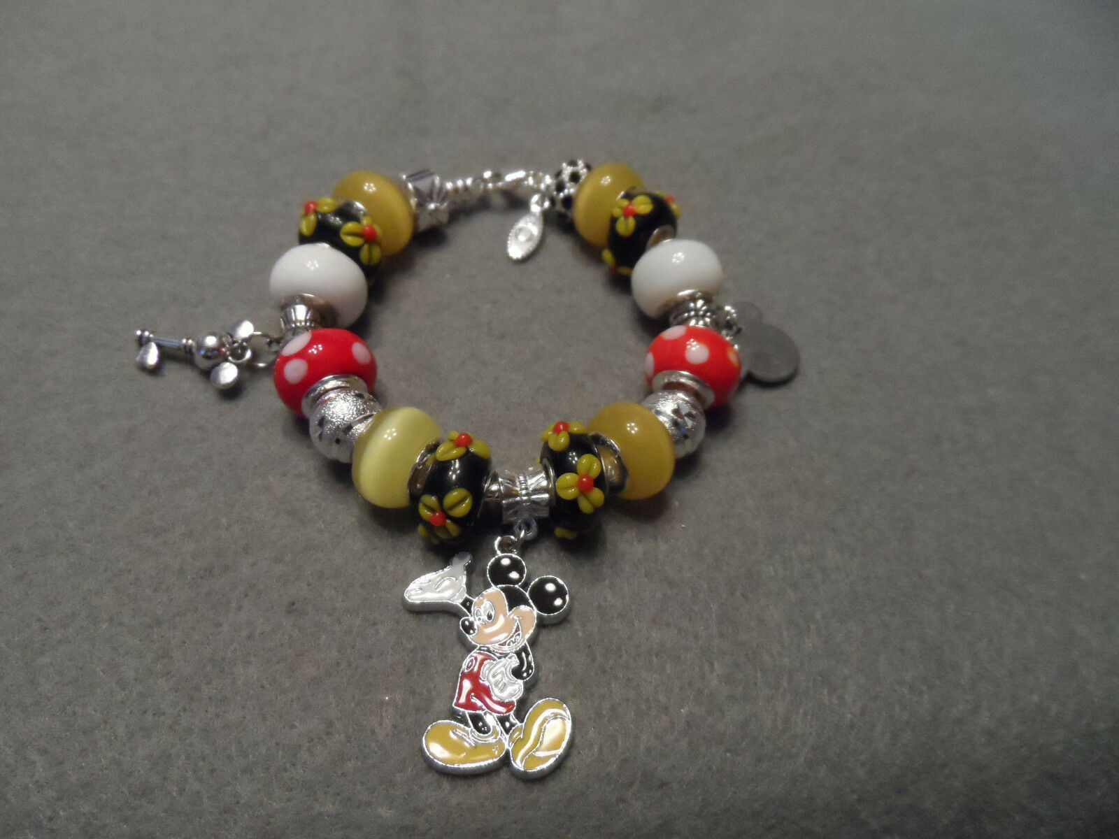 Authentic Pandora bracelet with Disney Mickey Mouse themed beads