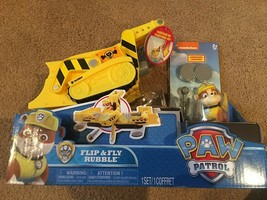 Paw Patrol Flip & Fly Rubble Transforming Vehicle with Launchers Spin Master - $27.71