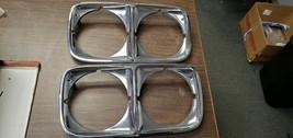 NOS 73 Pontiac Bonneville Catalina Grandville Headlight Doors Bezels GM 488216 - $197.99