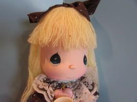 Precious Moments GREAT BRITIAN Doll the worlds children  YELLOW yarn  Ha... - $28.51