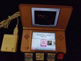 Nintendo DSi XL Metallic Rose Handheld System includes 3 games and trave... - $69.99
