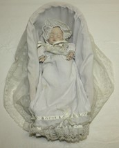 """9.5"""" Musical Animated Porcelain Baby Doll in Wicker Bassinet - $49.49"""