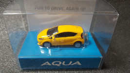 Toyota Aqua Light Keychain Yellow Pull Back Mini Car Japan Not Sold In Stores - $21.11