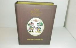 DISNEY Story book  Christmas Carolers Ornament... - $35.98