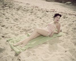 Ann Miller light pink swimsuit on sand sunbathing 16x20 Poster - $19.99