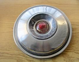 One factory original 1965 Chrysler Newport 14 inch hubcap wheel cover - $23.03