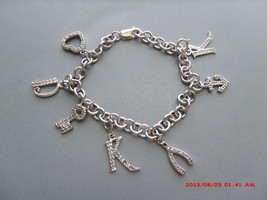"Signed Ati Sterling Silver 7"" Charm Bracelet With 7 Charms 15 Grams - $30.00"