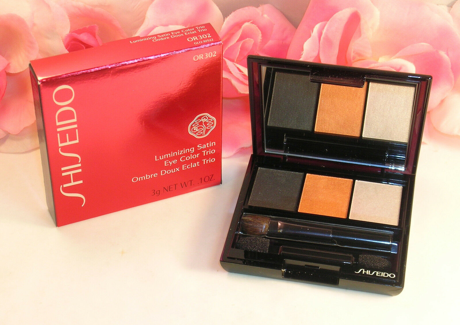 Primary image for New Shiseido Luminizing Satin Eye Color Trio OR302 .1oz 3g Grey Orange Highlight