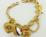 JUICY COUTURE Charm BRACELET Heart Bow Eat Candy with Cupcake Charm - 7 inches