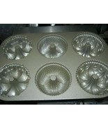 Nordic Ware Gold Cast-Aluminum Nonstick Multi Mini Bundt Pan - $24.04