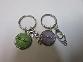 set of 2, Thelma & Louise handcuff handgun keychains, purple & green. #4... - $14.96