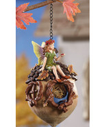Green Fairy Sitting On Acorn Birdhouse - $19.95