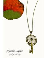 Heritage Drop Necklace: ivory vintage button, antique brass filigree foc... - $15.00