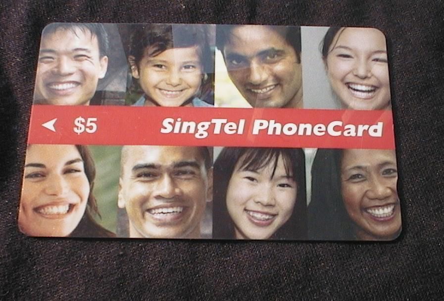 "SINGAPORE phonecard - $5 ""faces of Singapore"" USED"