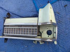 1973 MARQUIS LEFT HEADLIGHT BUCKET DOOR TRIM GRILL TRIM PANEL OEM USED MERCURY image 1