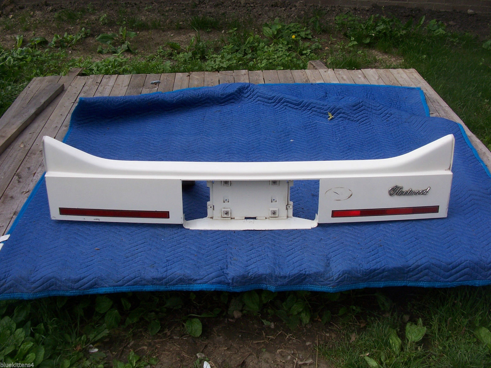 Primary image for 1985 FLEETWOOD FWD TRUNK TAIL FILLER VALANCE PANEL OEM USED ORIG CADILLAC GM #