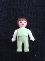 Geobra 2004 BABY FIGURE KID IN GREEN PAJAMAS 1.5 INCH HARD TO FIND PLAYM... - $4.32