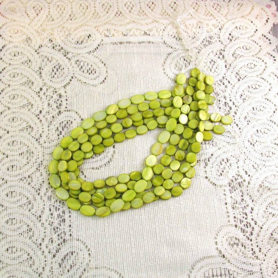 Mother of Pearl Flat Oval Shell Beads Green 12mm 1 16 in. str. 35 pc.