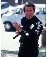 William Shatner in T.J. Hooker holding police truncheon 16x20 Canvas Giclee - $69.99