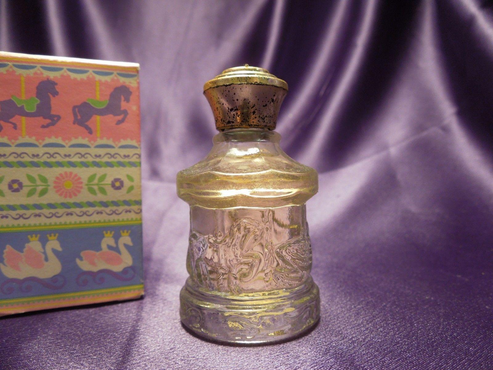 Avon Cologne Go Round Bottle Shape Honeysuckle Cologne .5fl Oz W/ Box