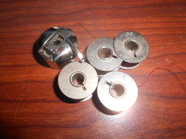 Bernina 830 Non Branded Bobbin Case #0015347200 w/5 BB Bobbins - $20.00