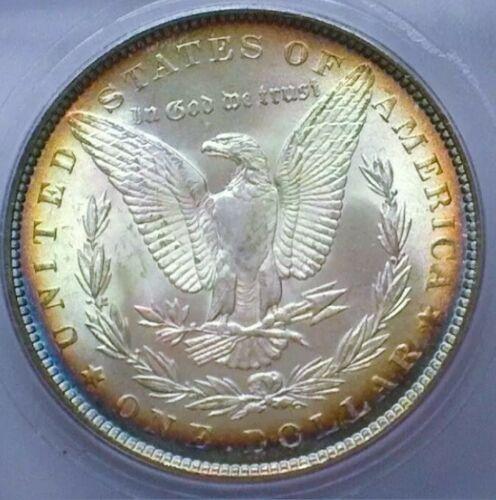 1888 MS65+++  MORGAN SILVER DOLLAR  * GORGOUS TONING. LOOKS HIGHER GRADE .