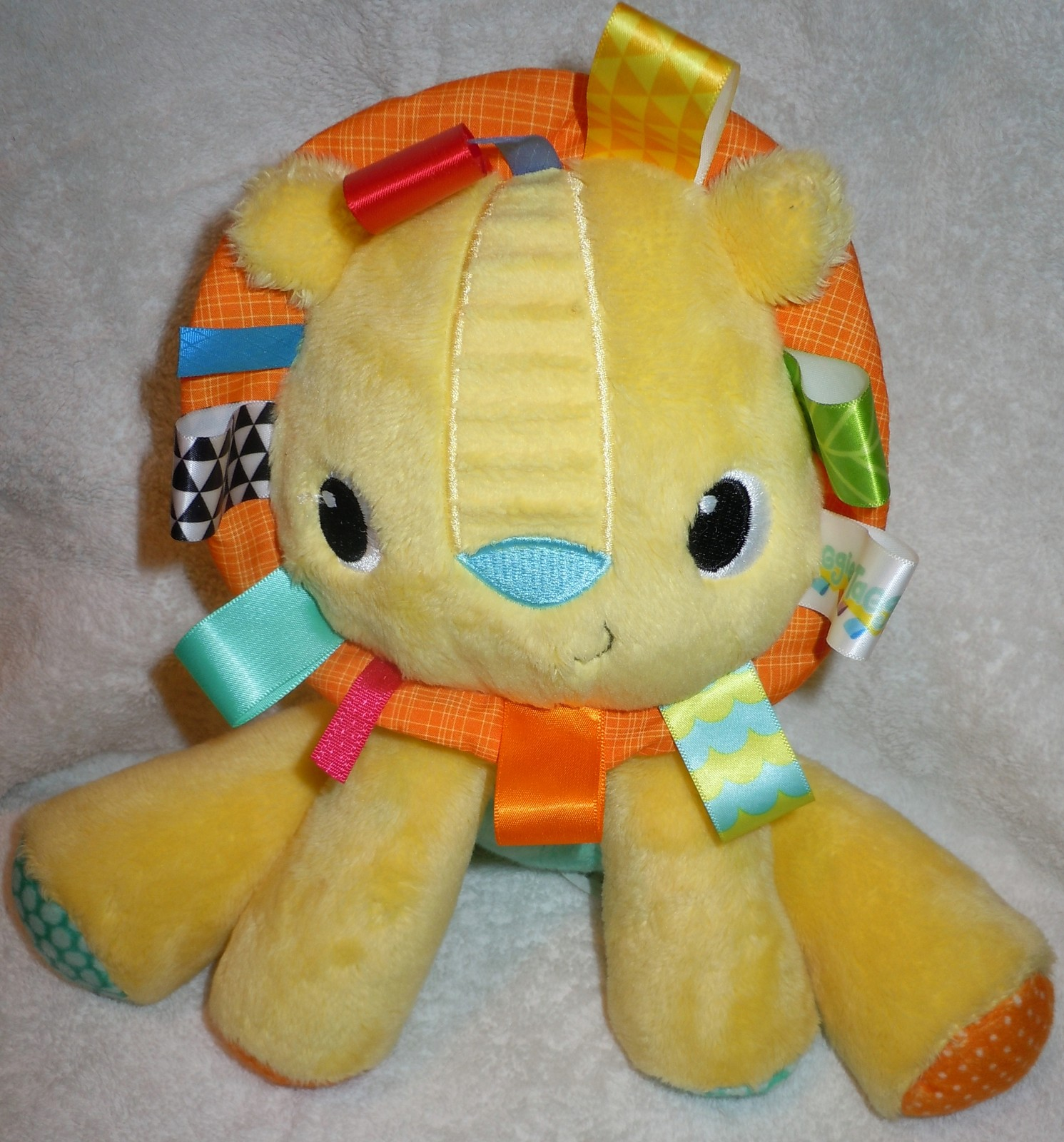 "Primary image for Bright Starts Yellow 9"" Plush Lion Rattle"