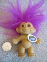 A Naked Good Luck Troll With Purple Hair - $14.66