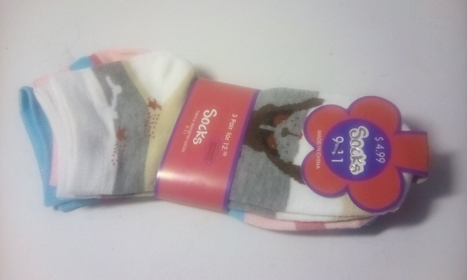 girls multi colored puppies socks size 9 - 11.