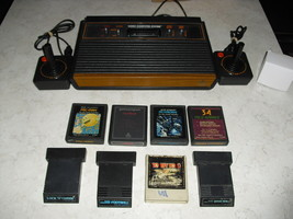 Atari 2600 4 SWITCH with joysticks, adapter, 8 GAMES  pac-man ,donkey kong - $148.49