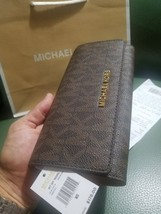 MICHAEL KORS iphone JET SET TRAVEL SIGNATURE LEATHER LARGE CARRYALL WALL... - $60.76