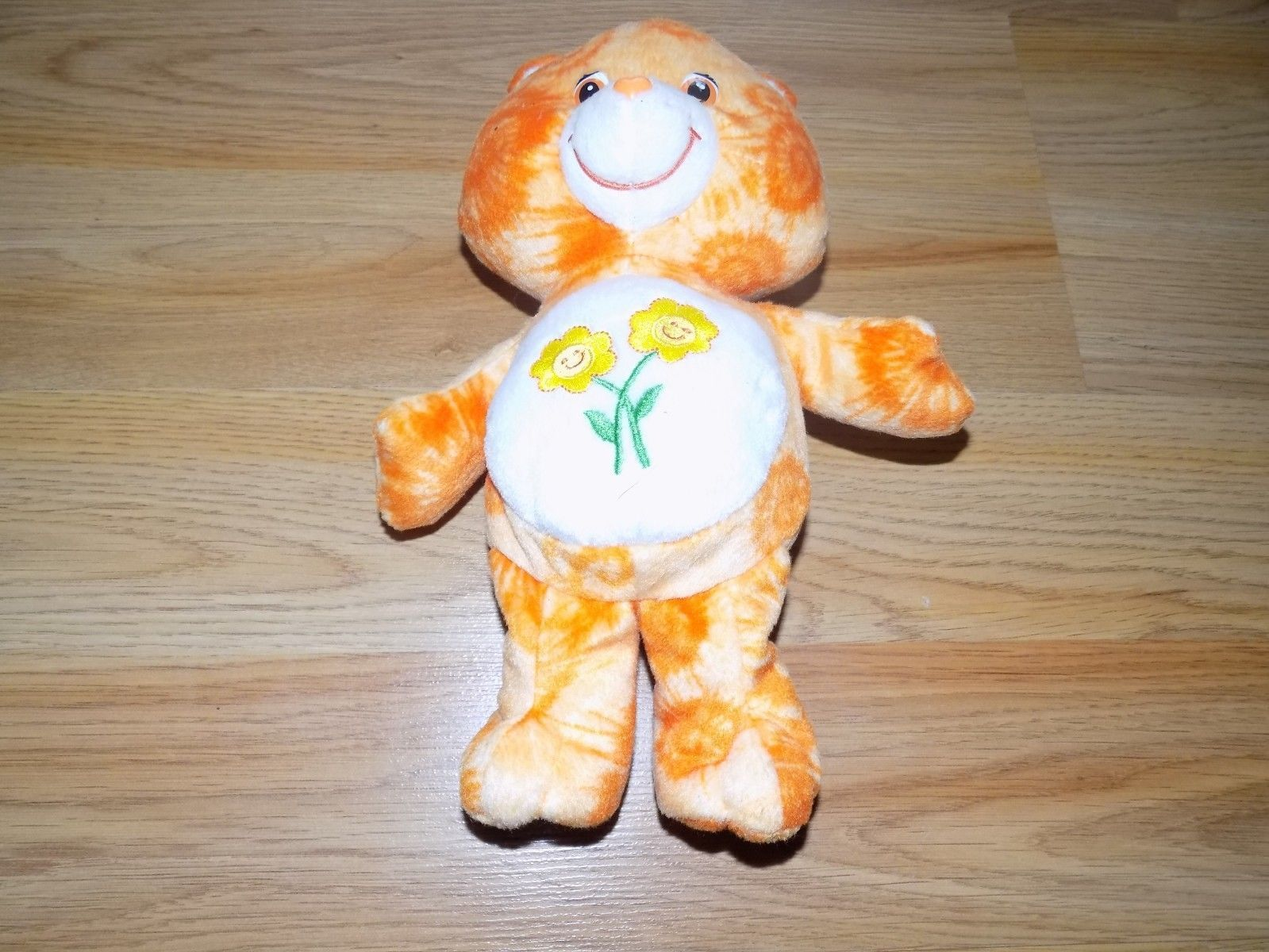 "Primary image for 11"" Friend Bear Care Bear Plush Orange Tie Dye Daisy Flower Tummy 2003 GUC"