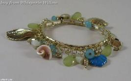 Gold Tone Sea Shore Charm Fashion Bracelet - $16.95